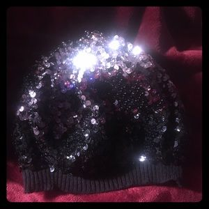Variegated bebe black and silver sequin knit cap
